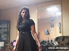 indian wife in bedroom dancing for hubby to tease him to make his mood for sex